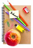 Back To School Supplies With Notebook, Red Apple  And Pencil On White  Background. Schoolchild And S