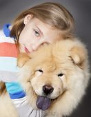 little girl hugging her dog chow chow