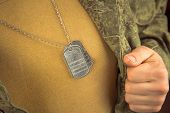 image of open shirt breast showing  - Breast of military man with badge space for text - JPG