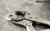 foto of workbench  - pincers on workbench close up abstract industry concept - JPG