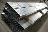 stock photo of tin man  - sheet tin metal profiles in production hall - JPG