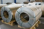 stock photo of tin man  - sheet tin metal rolls in production hall - JPG