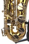 pic of belly button  - Belly of brass tenor saxophone with silver valves and pearl buttons on a stand in closeup - JPG