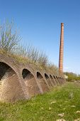 Ancient Brick Factory With Brick Kiln Holes And Chimney