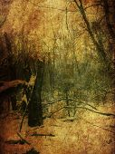 image of manila paper  - Vintage grunge yellow paper texture with winter bare trees landscape - JPG