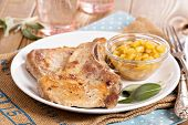 picture of pork cutlet  - Pork cutlets on a bone with apple and raisin chutney