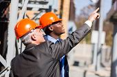 two male industrial managers working in electricity power plant