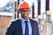 portrait of african industrial businessman in electrical substation