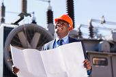 stock photo of substation  - african american industrial manager in electric substation - JPG