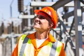 image of substation  - smiling mature male electrician in electrical substation - JPG