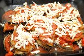 Close-up Of Eggplant Parmesan In A Black Baking Pan