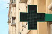 Pharmacy sign on the street. Green pharmacy sign.
