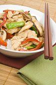 stock photo of crimini mushroom  - Stir fried chicken with mushrooms served over rice - JPG