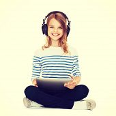 music, technology and shopping concept - child with headphones and tablet pc