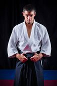 picture of aikido  - Aikido fighter on black background - JPG