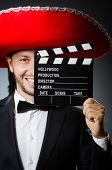 Mexican man with movie board clapboard