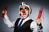 Funny clown with sticks of dynamite