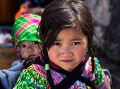 Unidentified Hmong Girl Carrying Baby In Sapa, Lao Cai, Vietnam