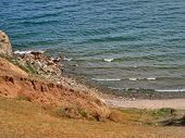 Nature Of Lake Baikal. View Of The Rocky Shore And Surf