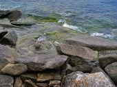 Nature Of Lake Baikal. Rolling Waves On Coastal Rocks