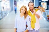 Young couple posing in shopping mall