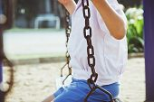 child swinging at a playground