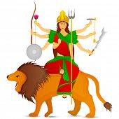 Statue of Goddess Durga sitting on her lion and holding weapons in her each hands.