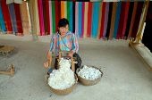 woman prepares cotton fibers