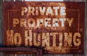 Rusty No Hunting Sign