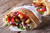 Shawarma In Pita Bread Close-up On The Table Horizontal