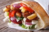 Kebab With Meat, Vegetables And Fries In Pita Bread