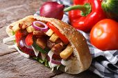 picture of shawarma  - delicious shawarma with meat vegetables and fries in pita bread closeup horizontal - JPG