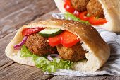 stock photo of pita  - falafel with vegetables in pita bread closeup on wooden table horizontal - JPG