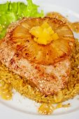 chicken fillet baked with pineapple, with rice and salad