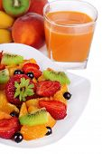 Fresh fruits salad on plate with berries and juice close up
