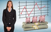 Businesswoman with piggy banks and money