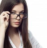 stock photo of shot glasses  - closeup portrait of attractive  caucasian  woman brunette isolated on white studio shot lips  face hair head and shoulders looking at camera glasses businesswoman - JPG