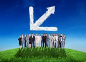 Composite image of business people standing up against cloud graph