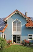 Modern New Built House And Garden, Rooftop With Solar Cells