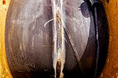 image of pipe-welding  - The close up weld on a steel pipes for a new heat line - JPG