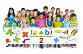 Diverse Cheerful Children Holding Mathematical Symbols