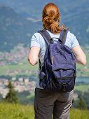 Woman Walks Down A Mountain