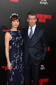 LOS ANGELES - AUG 13:  Olga Kurylenko, Pierce Brosnan at
