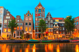 picture of gable-roof  - Night city view of Amsterdam canal Herengracht with typical dutch houses boats and bicycles Holland Netherlands - JPG