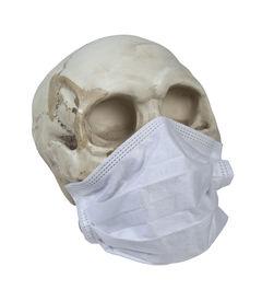 stock photo of eye-sockets  - Skull with eye sockets wearing a whitle medical mask  - JPG