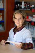 young female pharmacist holding prescription