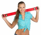 stock photo of red-necked  - Pretty girl in shirt holding red building level of the neck - JPG