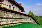 White House, Stone Fence With Roof Tile And Lawn
