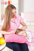 Little Girl Sleeping On Mother's Lap