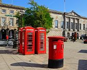 Red postbox and telephone boxes, Stafford.